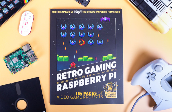 Retro Gaming with Raspberry Pi book on a table surrounded by a Raspberry Pi and retro gaming hardware