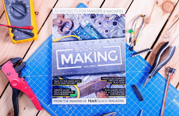 Book of Making Volume 1 book on a table surrounded tools for making electronics projects
